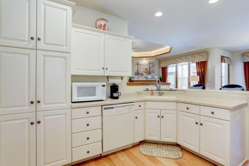 Kitchen with Corian countertops is FULL of cabinet space
